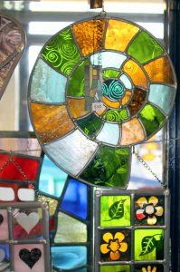 Ammonite stained glass panel - Cariia Glass